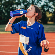 girl in athletic jersey drinking out of my next promo water bottle